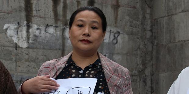 2009年9月、北京で居住権保護を訴える毛恒鳳(C)AI