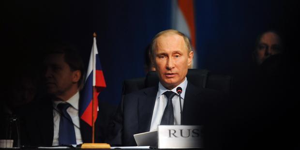 外国エージェント法は、プーチンの弾圧的政策の中核をなす。(C) AP Photo/Sabelo Mngoma