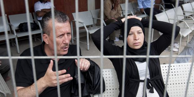 Nariman Tamimi has suffered arrests and raids on her home and her husband, Bassem, has been jailed at least twice.(C) AHMAD GHARABLI/AFP/GettyImages