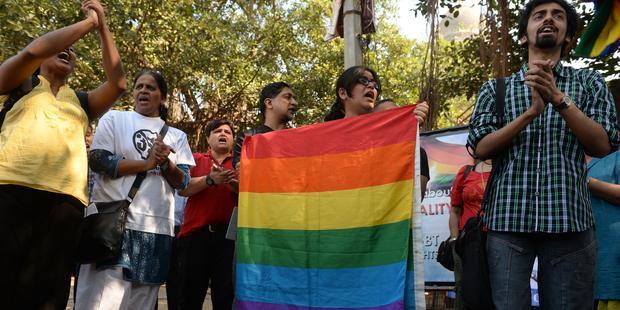 最高裁の判決に抗議する活動家たち (C) AFP/Getty Images