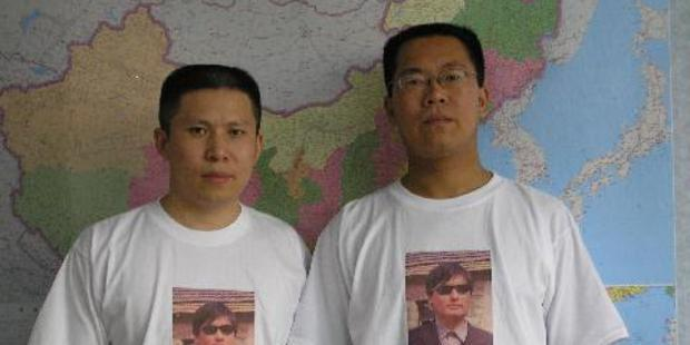 Chinese human rights activist Xu Zhiyong (left) was sentenced to four years in jail on Sunday.(C) Private