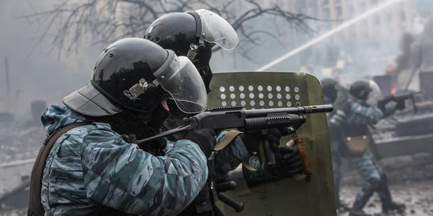 There is growing evidence from across Ukraine of vigilante groups colluding with the police (pictured firing rubber bullets).(C)Brendan Hoffman/Getty Images