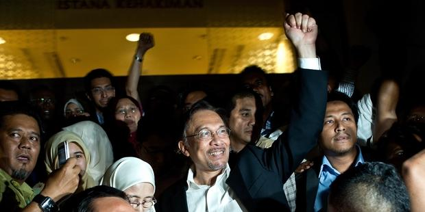 Police in Malaysia are re-opening a sedition investigation relating to a speech given by opposition leader Anwar Ibrahim.(C)MANAN VATSYAYANA/AFP/Getty Images