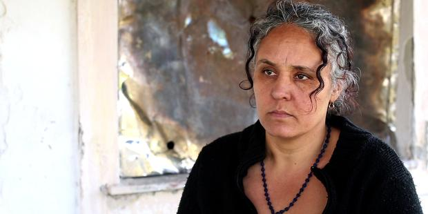 Paraskevi Kokoni and her nephew were punched, kicked and beaten with logs by a group of men.(C)Amnesty International