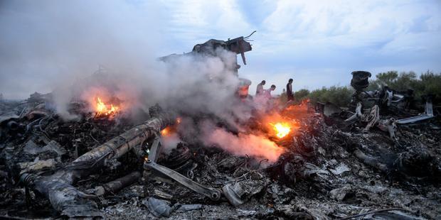 激しい対立が続くウクライナ東部で起きた旅客機の墜落で、300人近くが命を落とした。(C) EPA/ALYONA ZYKINA EPA/ALYONA ZYKINA.