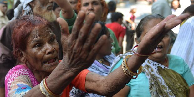 Survivors and activists have long criticized the Indian government for massively underestimating the number of dead and injured after the Bhopal gas leak.(C) PUNIT PARANJPE/AFP/Getty Images