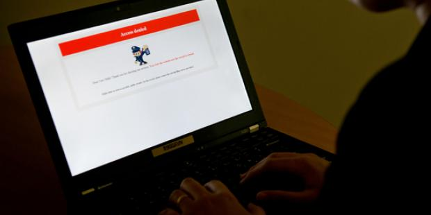 A laptop displays a denial of access message for a website blocked in Beijing. (C)STF/AFP/Getty Images