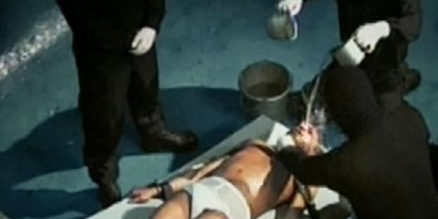 """Simulation of waterboarding, one of the so-called """"enhanced interrogation techniques"""" used by the USA.(C)Amnesty International"""