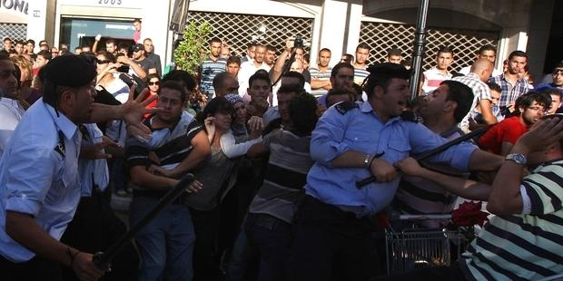 Dozens of Palestinian police attacked peaceful protesters during two demonstrations in Ramallah.