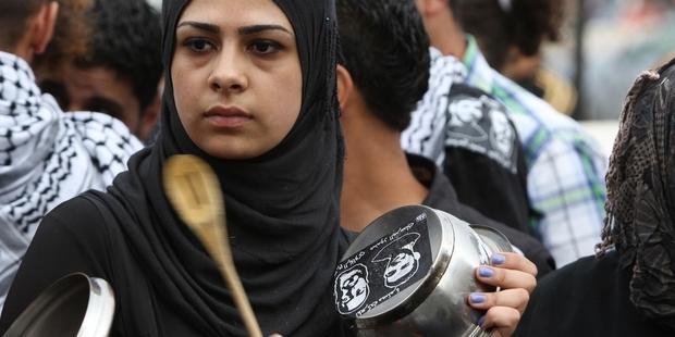 抗議を行うパレスチナ人(C) ABBAS MOMANI/AFP/GettyImages