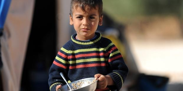 A Syrian boy looks on in a newly built refugee camp.(c)AFP/Getty Images