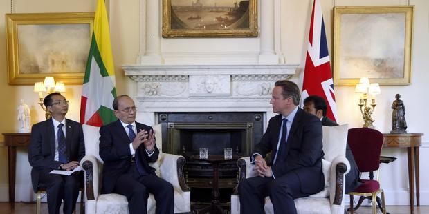 ビルマの大統領は、訪問先のロンドンですべての良心の囚人の釈放を宣言した(C) 2013 Getty Images