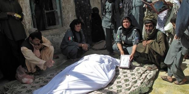 Lieutenant Negar, 38, died on Monday morning in hospital after two unidentified gunmen on a motorbike shot her in the neck on Sunday near police headquarters in Lashkar Gah.(C)AFP/Getty Images