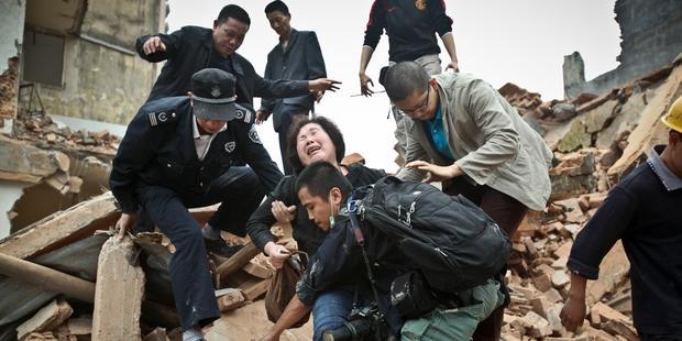 中国では、暴力をともなう強制立ち退きが横行している。© Benjamin gz - Imaginechina