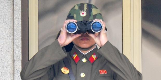 政府は「無許可で出国する者は罰する」と明言した。(C) KIM JAE-HWAN/AFP/Getty Images