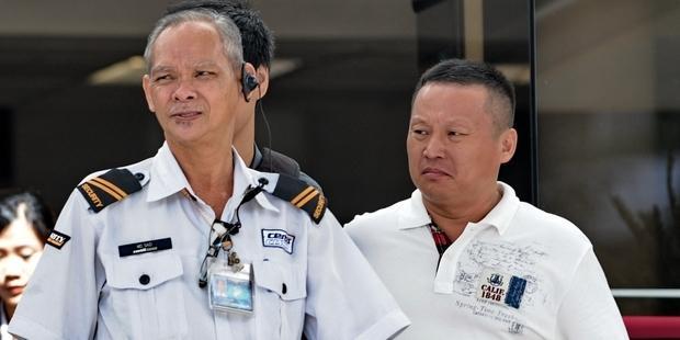 シンガポール当局に起訴された、4人のバス運転手のうちの一人、王獻傑。(C) ROSLAN RAHMAN/AFP/Getty Images